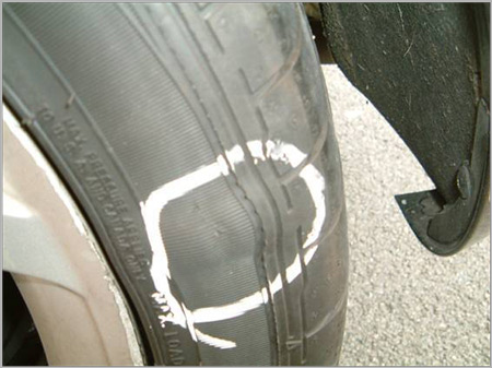 Check for tire bulges
