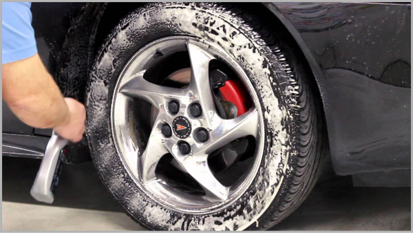 Washing Car Tire with soap and water